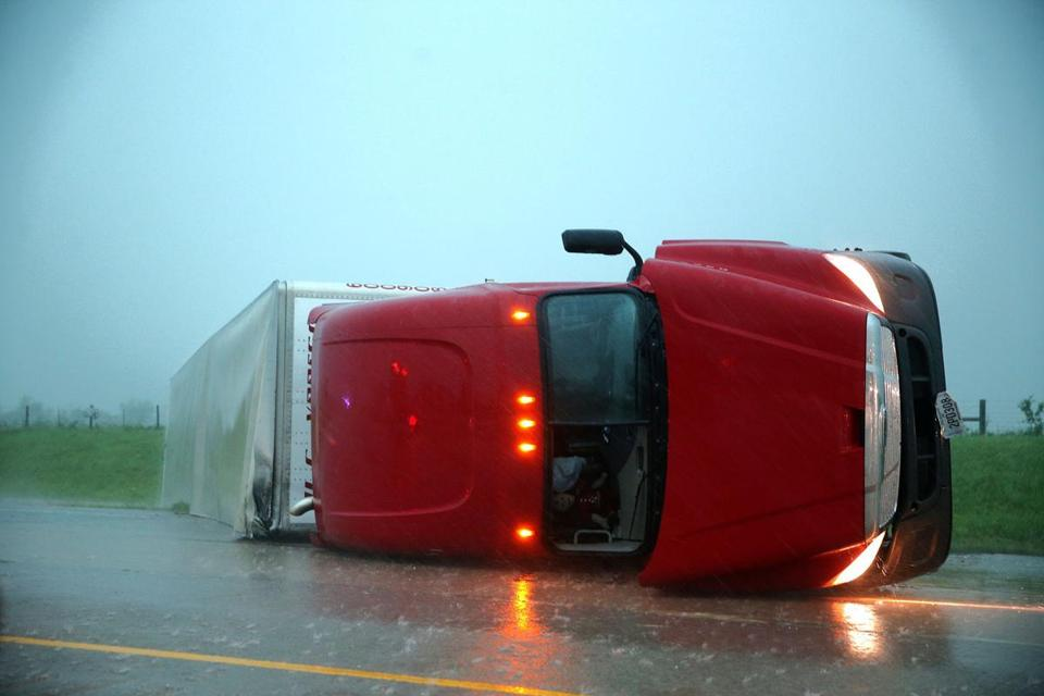 An overturned tractor-trailer rested on its side in the eastbound lanes of Interstate 40, just east of El Reno, Okla., after a reported tornado touched down.