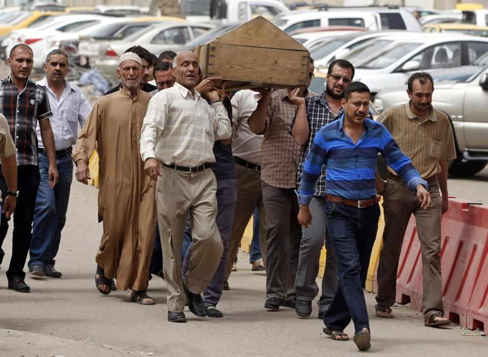 Mourners carried the coffin of a man killed in a liquor store attack in Baghdad, Iraq. More than a year after US forces left Iraq, the renewed sectarian violence raises fears that Iraq  and other nations in the region could slide into chaos.