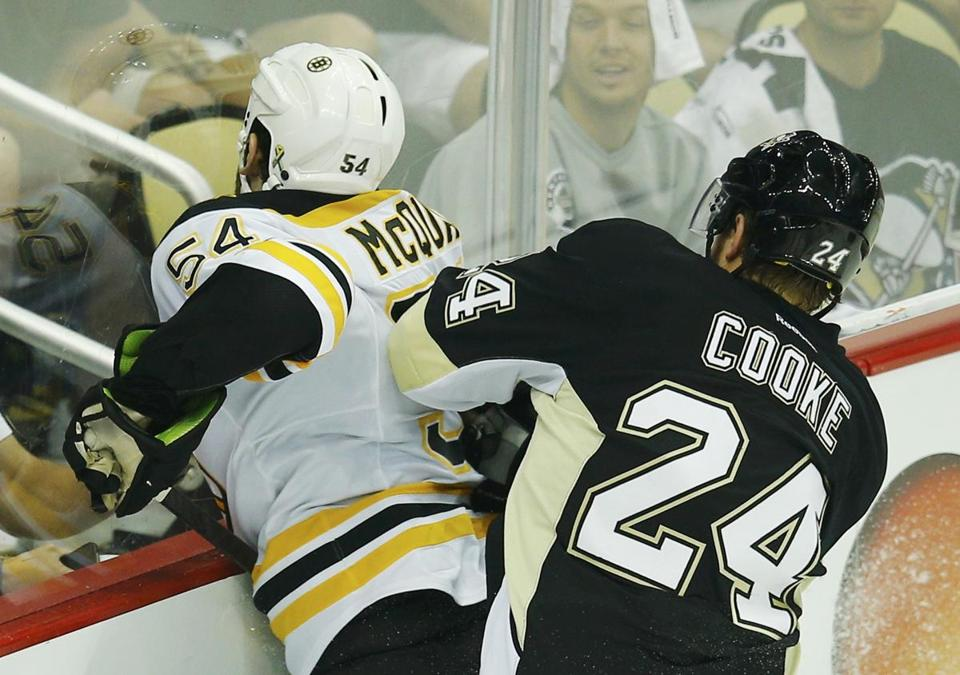 The Penguins' Matt Cooke drilled Bruins defenseman Adam McQuaid right between the numbers with 1:32 gone in the second period of Game 1.