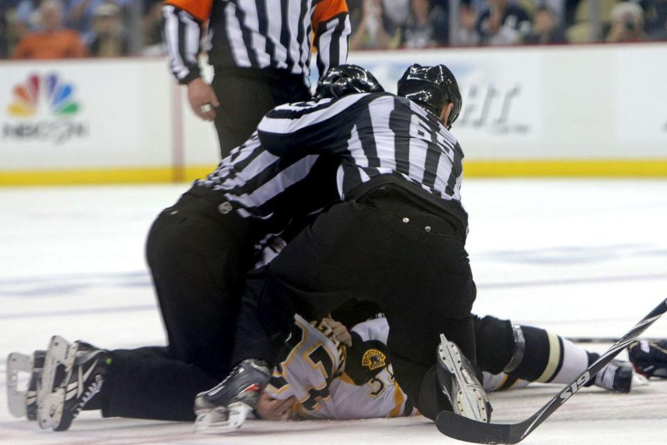 Patrice Bergeron and Evgeni Malkin are at the bottom of the pile. two players who rarely drop the gloves.