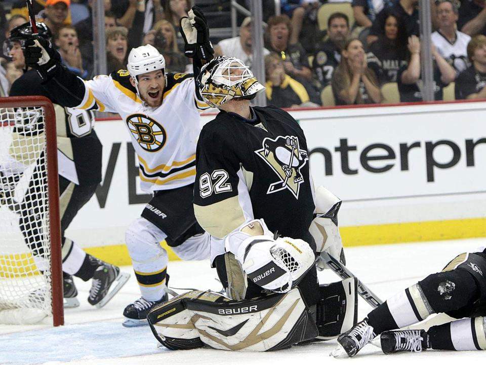 Bruins defenseman Andrew Ference celebrates the first of David Krejci's two goals in Game 1 as he skates by frustrated Pittsburgh goaltender Tomas Vokoun.