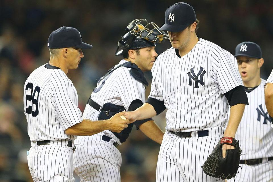 Joe Girardi takes the ball from starter Phil Hughes, who was knocked out in the fifth.