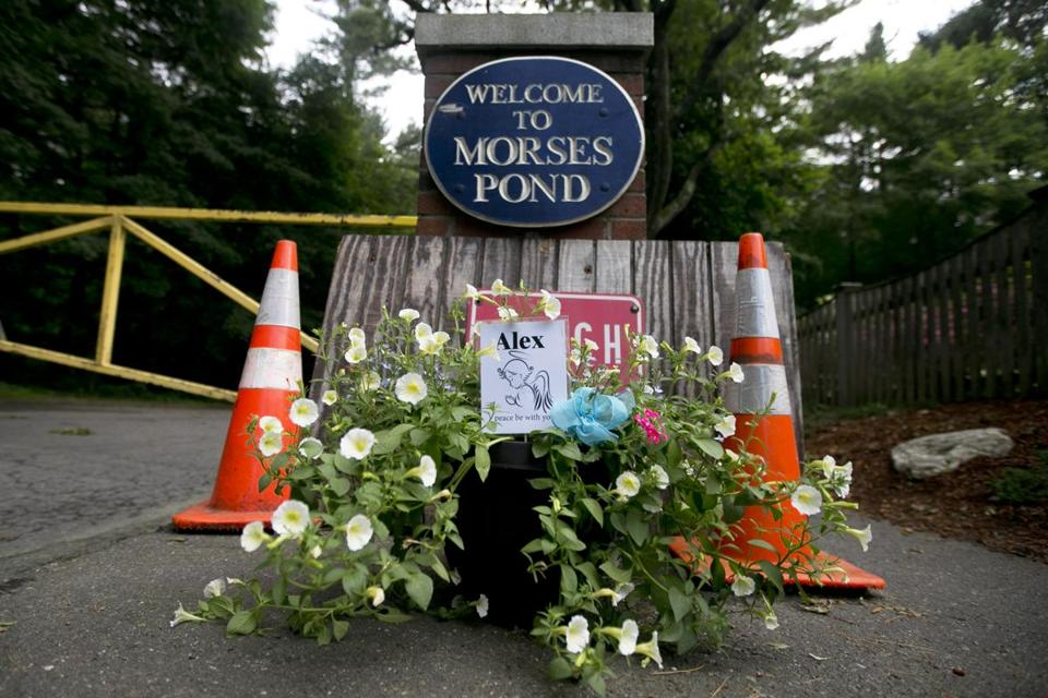 "An arrangement of flowers with a card that beared the name ""Alex"" lay at the entrance of Morses Pond."