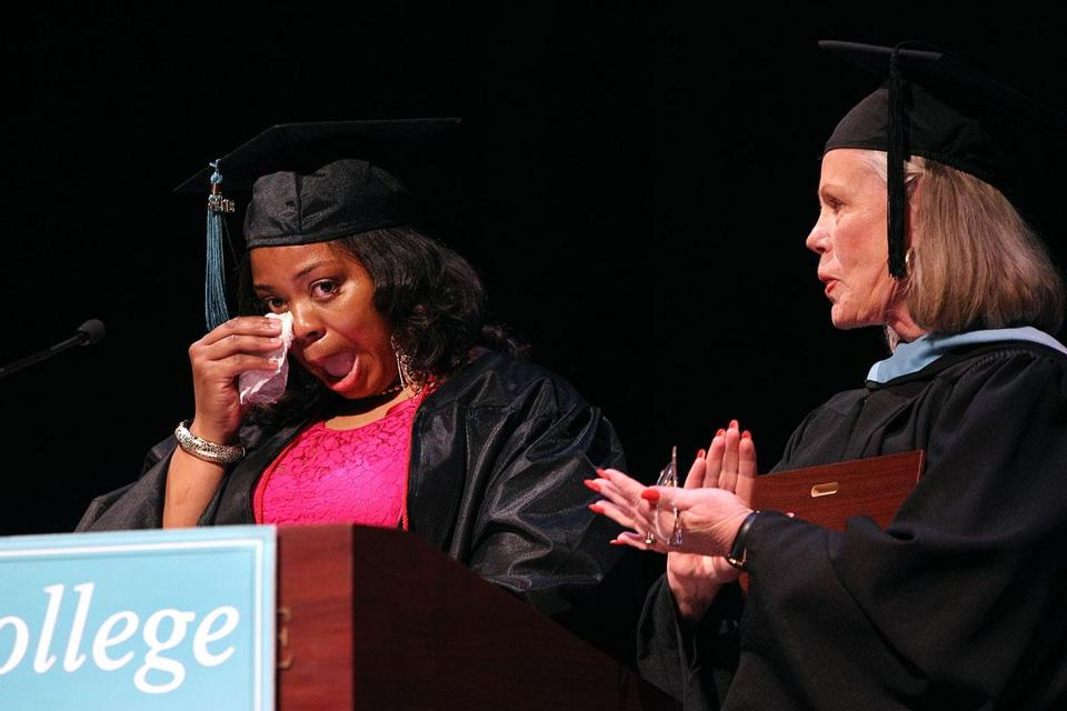 Nancy Daniel (right), Urban College's dean of academic affairs, applauded as graduate Cecelia Young composed herself while accepting the Jill Alexander Award for Excellence at commencement Sunday.