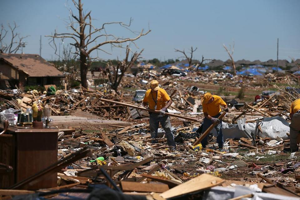 Volunteers sifted through the tornado-destruction rubble of homes Sunday in Moore, Okla. Residents are still trying to recover two weeks after the devastating wind storm.
