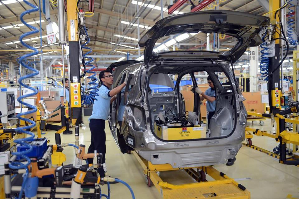 GM has profited each quarter since its November 2010 IPO. Above, a factory in Indonesia.