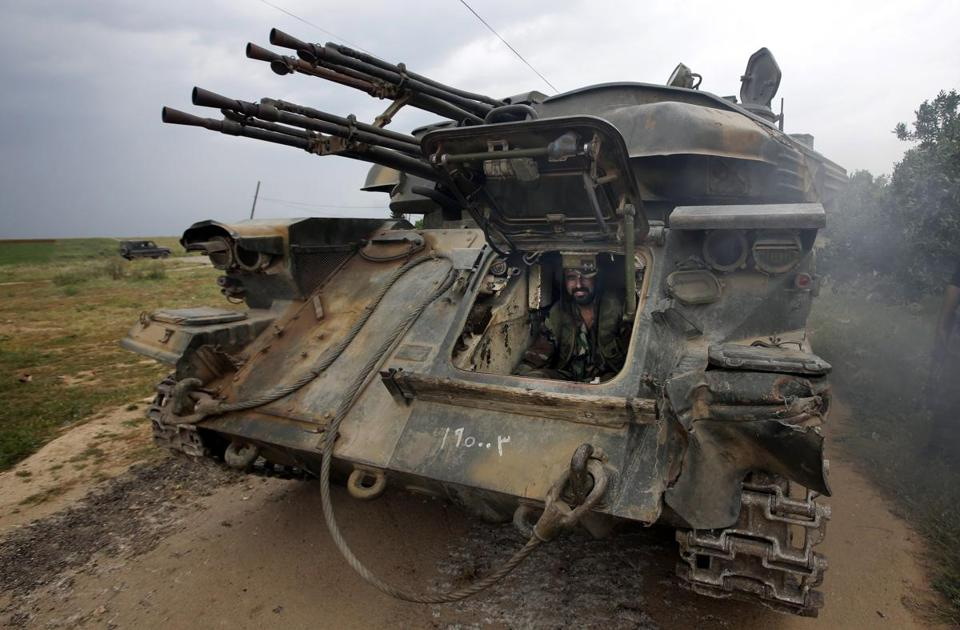 A Syrian soldier sat inside a tank as troops loyal to Bashar Assad took control of the village of Western Dumayna last month.
