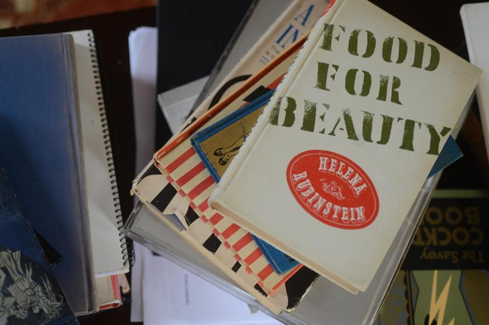 Michelle Tolini Finamore used her collection of cookbooks by fashion designers to put together a lunch at the MFA, where she is a curator.
