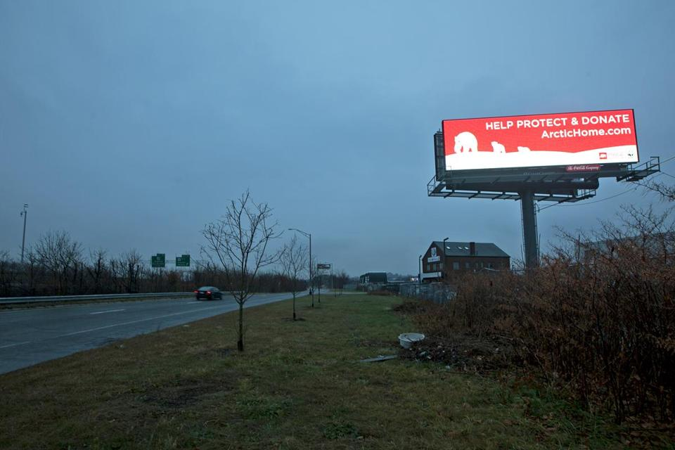 A billboard advertising Coca-Col on the Mystic Valley Parkway.