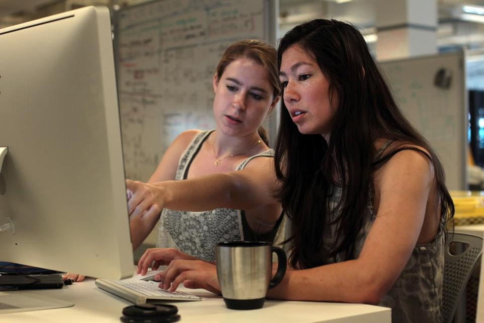 Emily Breslow (left) and Alana Pradhan work at the Harvard iLab for a start-up called Bobo Analytics.