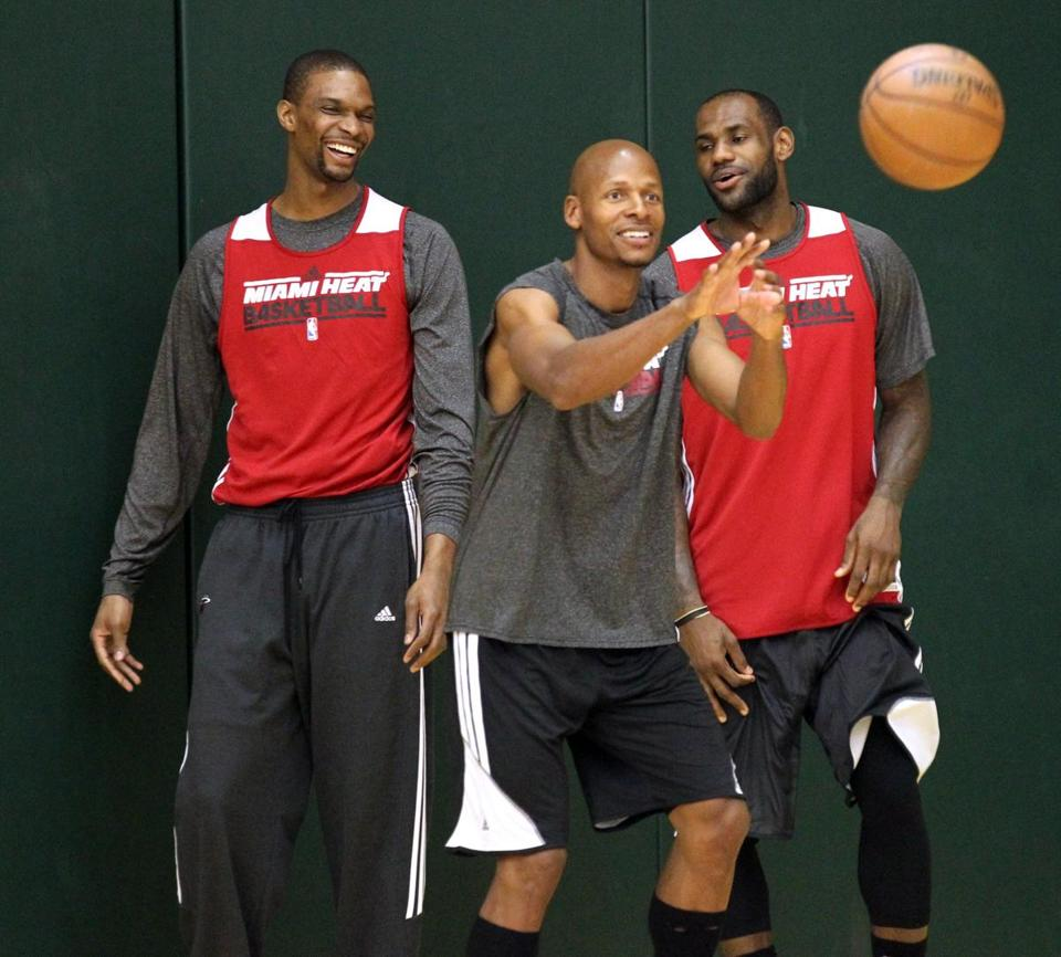 Chris Bosh (left) and LeBron James (right) are glad to have Ray Allen on their side.