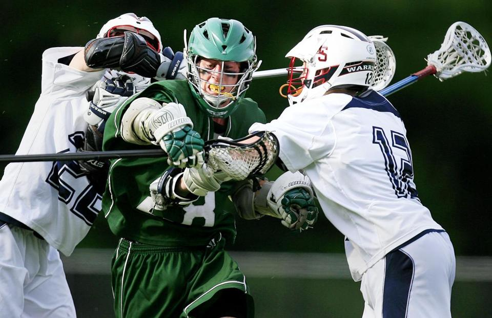 Billerica's Kevin Farrell fights his way  between Lincoln-Sudbury's Greg Roder (left) and John Sexton in Lincoln-Sudbury's 14-1 victory in the Division 1 lacrosse quarterfinals.