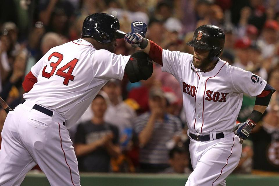 David Ortiz (left) and Dustin Pedroia exchanged fist bumps after Pedroia tied a June game with the Texas Rangers.