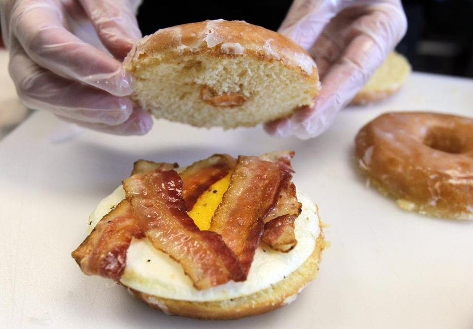 The doughnut bacon sandwich prepared at Dunkin' Donuts test kitchen in Canton.