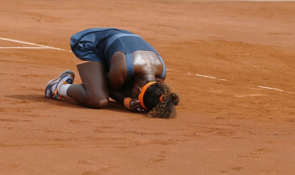 Serena Williams celebrates her victory over Maria Sharapova in the women's final at the French Open.