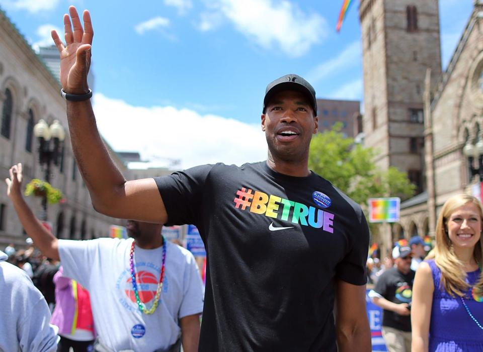 Former Boston Celtic Jason Collins waved to crowds on Boylston Street during the Gay Pride Parade.