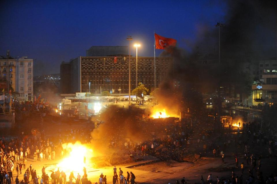 Protestors clash with Turkish riot police in Taksim square on Tuesday evening.