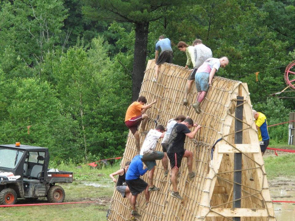 Participants clambered over a wall in the Warrior Dash at Amesbury Sports Park last year.