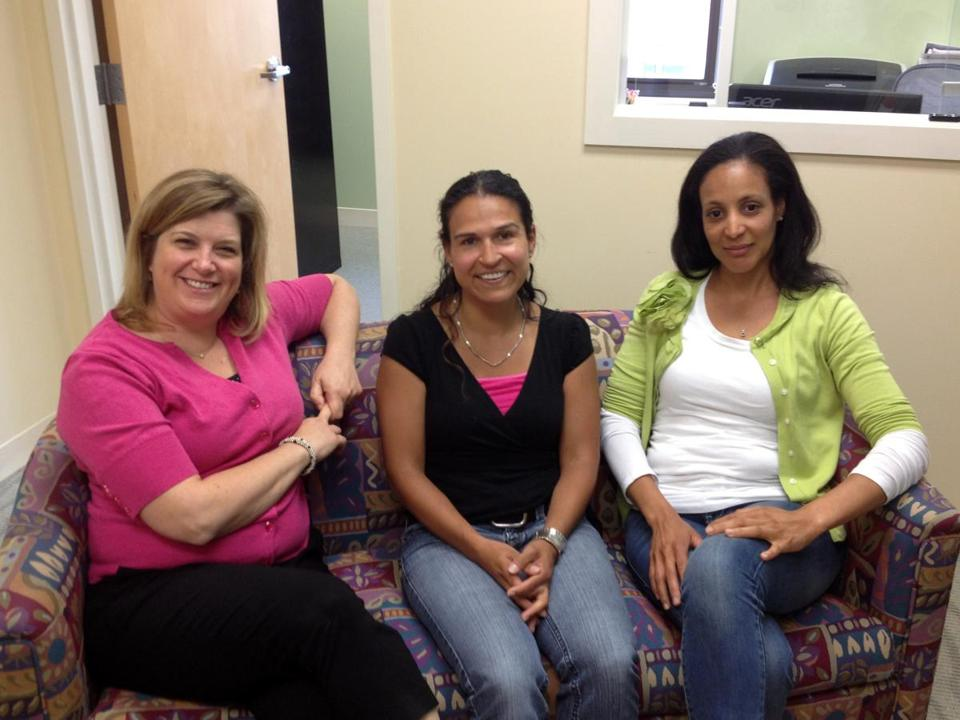 Staff from Plummer Home in Lowell constantly reinforce their philosophy of permanence. From left are Jennifer Knapp Hernandez, MaryLuz Arling, and Nancy Vargas.