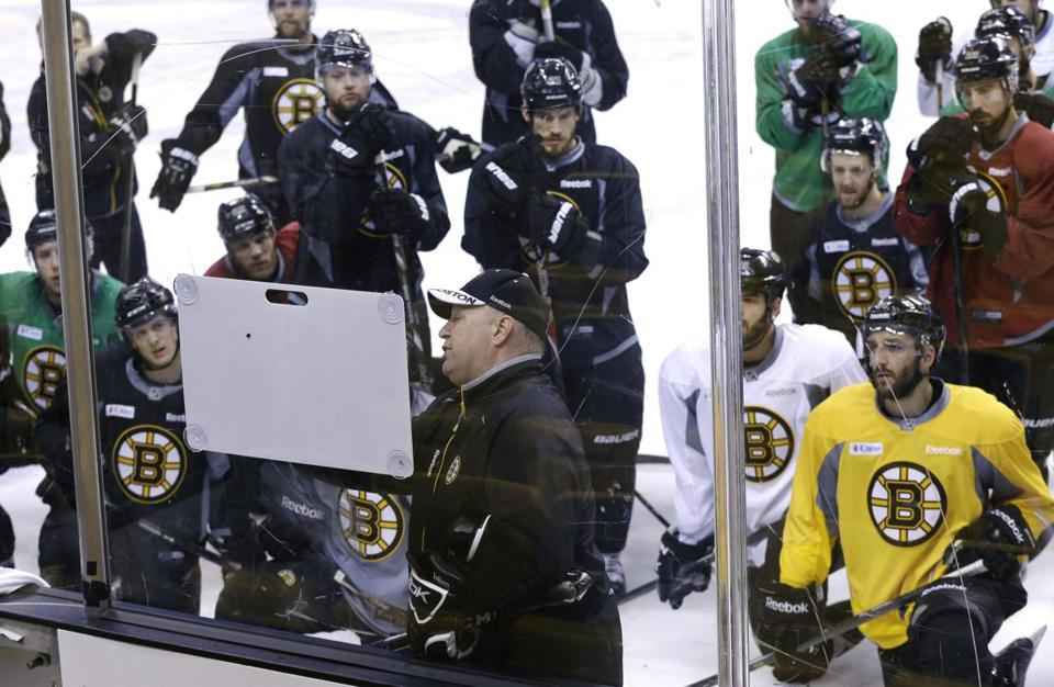 The team gathered around Bruins head coach Claude Julien during practice on Monday.