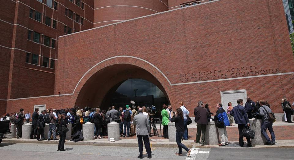 "Reporters were outside the federal courthouse Wednesday as opening arguments began in James ""Whitey"" Bulger's trial."