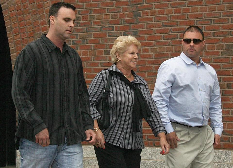"Patricia Donahue, with sons Tom (left) and Michael, left the Moakley Courthouse after the opening day of arguments in the trial of James ""Whitey"" Bulger."