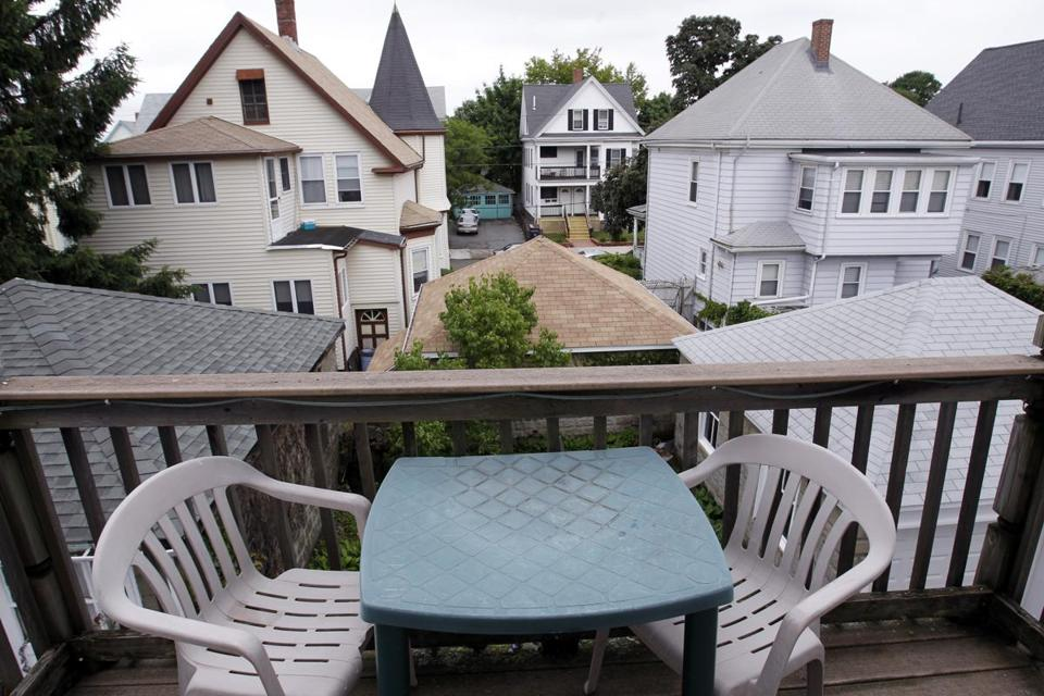 The back porch of an Everett two-family home, listed for $399,900 by Century 21 North Shore.