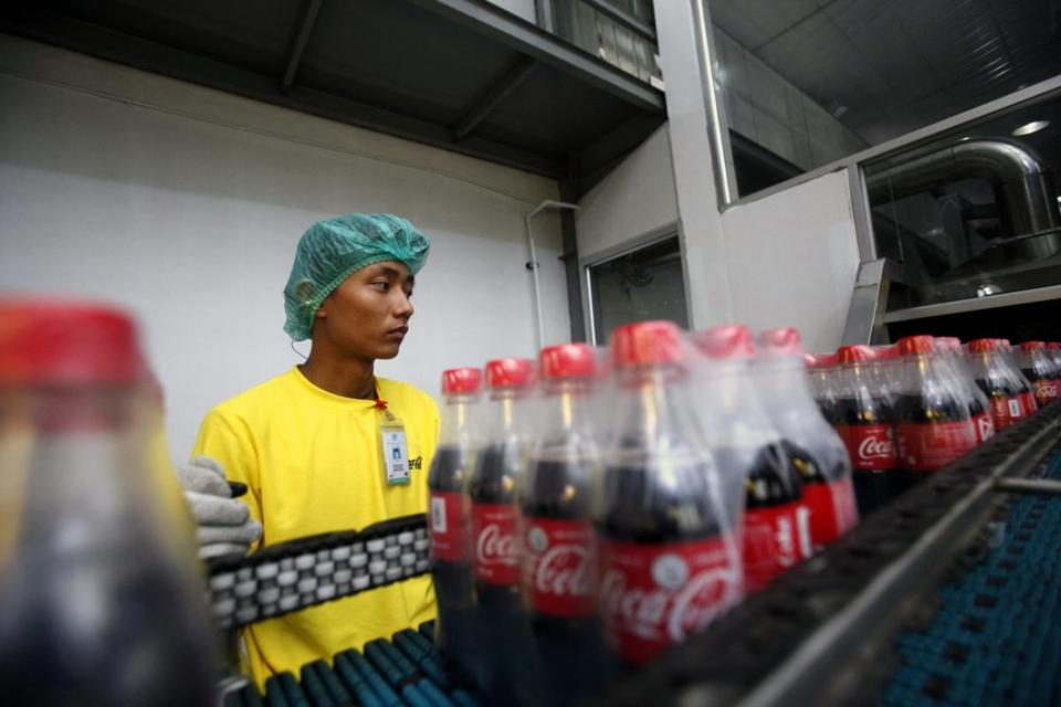A man worked in the Coca-Cola bottling plant near Yangon, Myanmar.