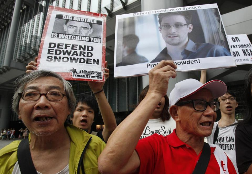 Supporters of Edward Snowden chanted during a demonstration before marching to the US Consulate in Hong Kong on Thursday. Snowden's disclosures have raised concerns that the National Security Administration may have hacked into Hong Kong's key Internet exchange.