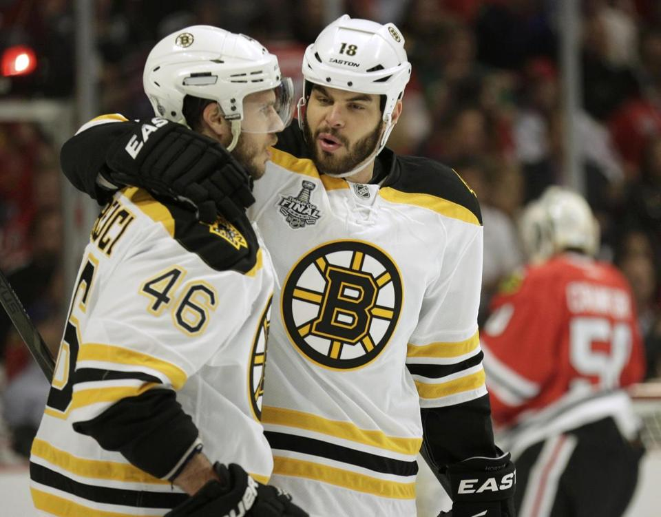 Nathan Horton, right, celebrated with David Krejci after  assisting on Milan Lucic's first period goal.