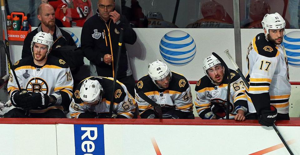 The Bruins appeared dejected after the Blackhawks' winning goal.