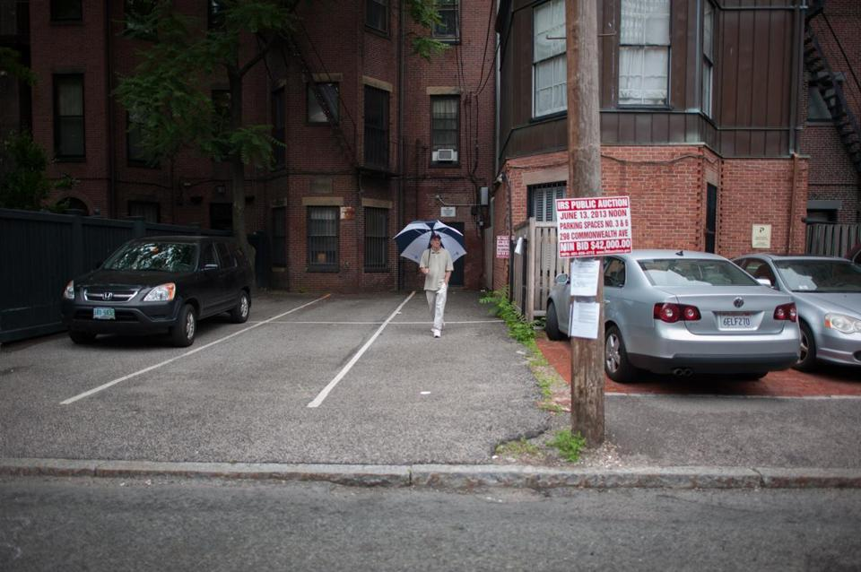 Bidding for the weed-bordered tandem parking spaces began at $42,000. They were claimed for $560,000.