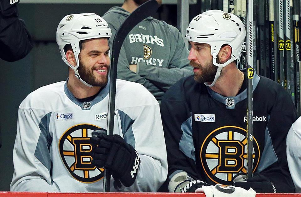 Nathan Horton (left), chatting with Zdeno Chara on the bench , did not display any problems shooting or passing.