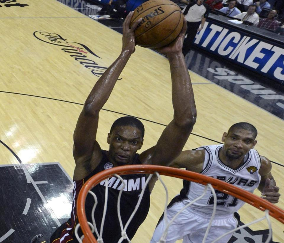 Miami's Chris Bosh, dunking on Tim Duncan, delivered his best performance of the playoffs in Thursday's Game 4.