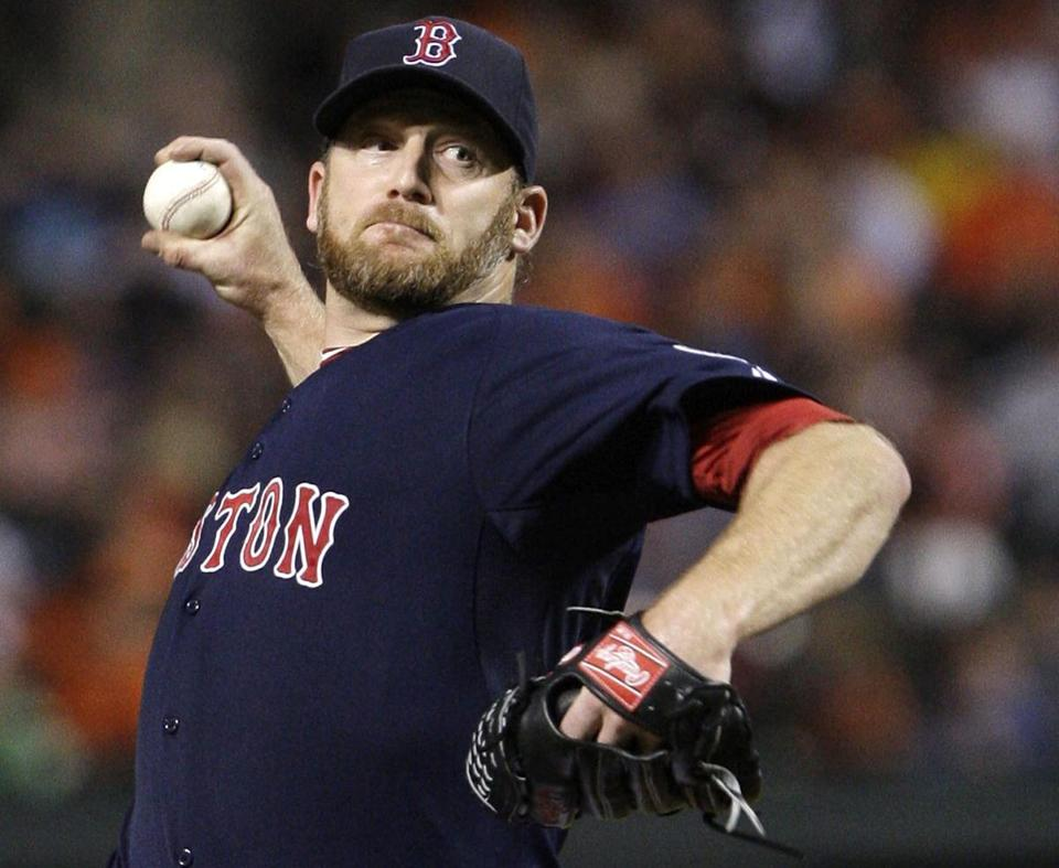 Ryan Dempster pitched into the eighth inning, giving up two runs on five hits in his first career appearance at Camden Yards after 16 seasons in the majors.