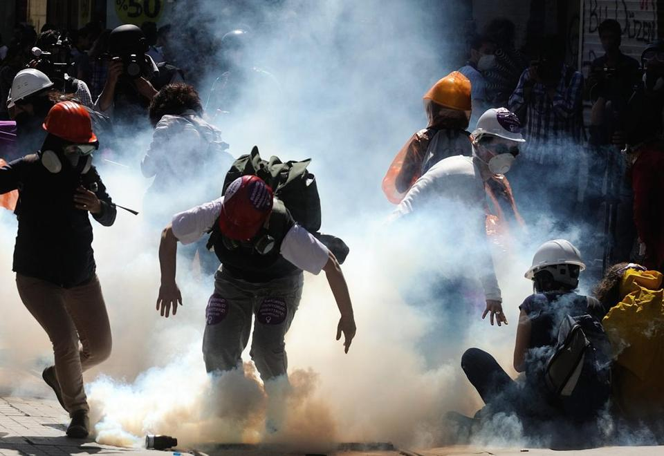 Protesters fled amid tear gas during clashes in Istanbul on Sunday. The park in Taksim Square that was the focus of the demonstrations was cleared Saturday night.