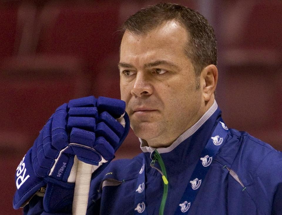 Former Canucks coach Alain Vigneault has been hired by the Rangers, according to reports out of New York.
