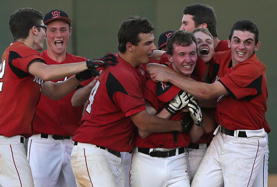 Cody Clifford (center right) gets his just reward, a team hug, after knocking in the winning run in the 12th inning