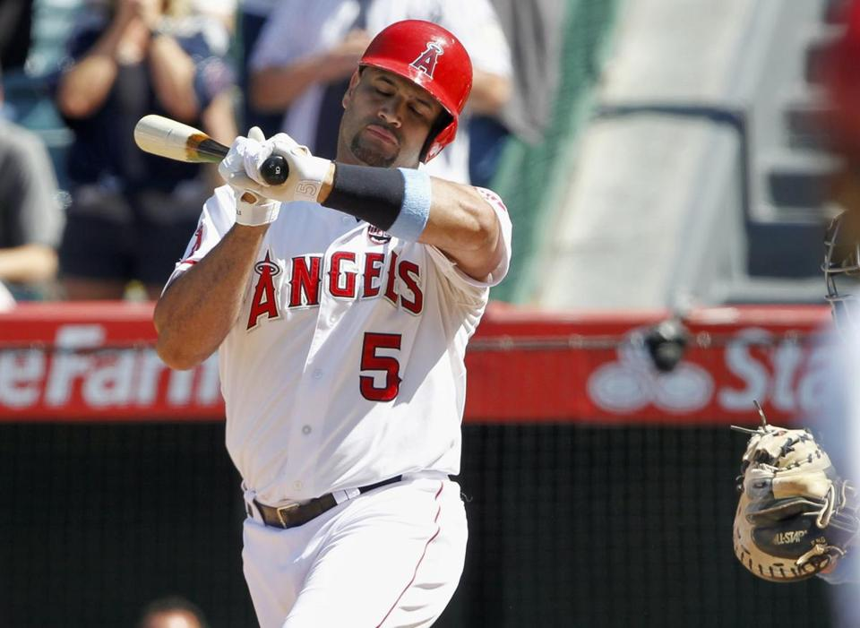 Albert Pujols fails to check his swing on a third strike, ending the Angels' comeback bid against the Yankees.