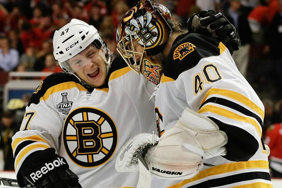 Torey Krug congratulates Tuukka Rask following the Bruins' win in Game 2.