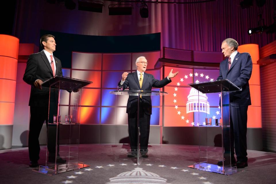 Republican Gabriel Gomez (left) and Democrat Edward Markey (right) were able to question each other directly in Tuesday night's debate, moderated by R.D. Sahl (center).