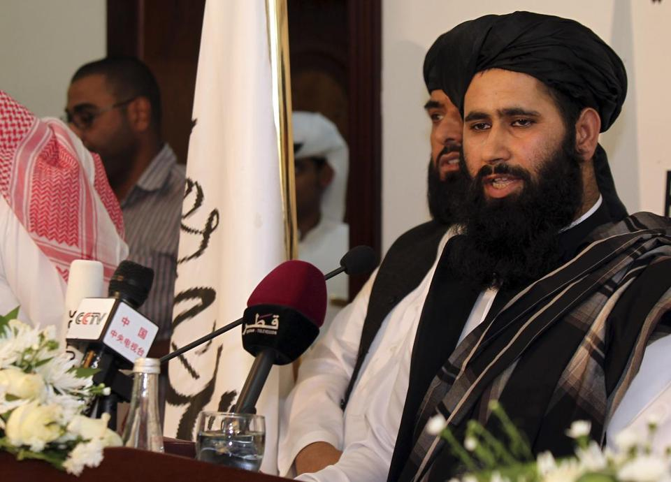 Taliban representative Muhammad Naeem spoke at the official opening of the group's office in Doha, Qatar Tuesday. US envoys are to meet with representatives this week.