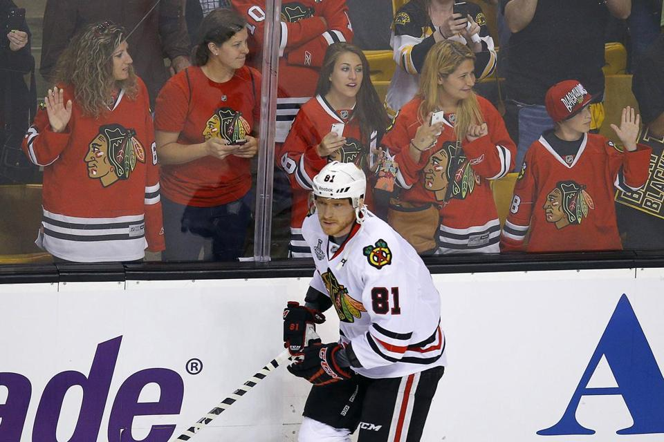 Marian Hossa took part in warm-ups for Game 3 before he was scratched.