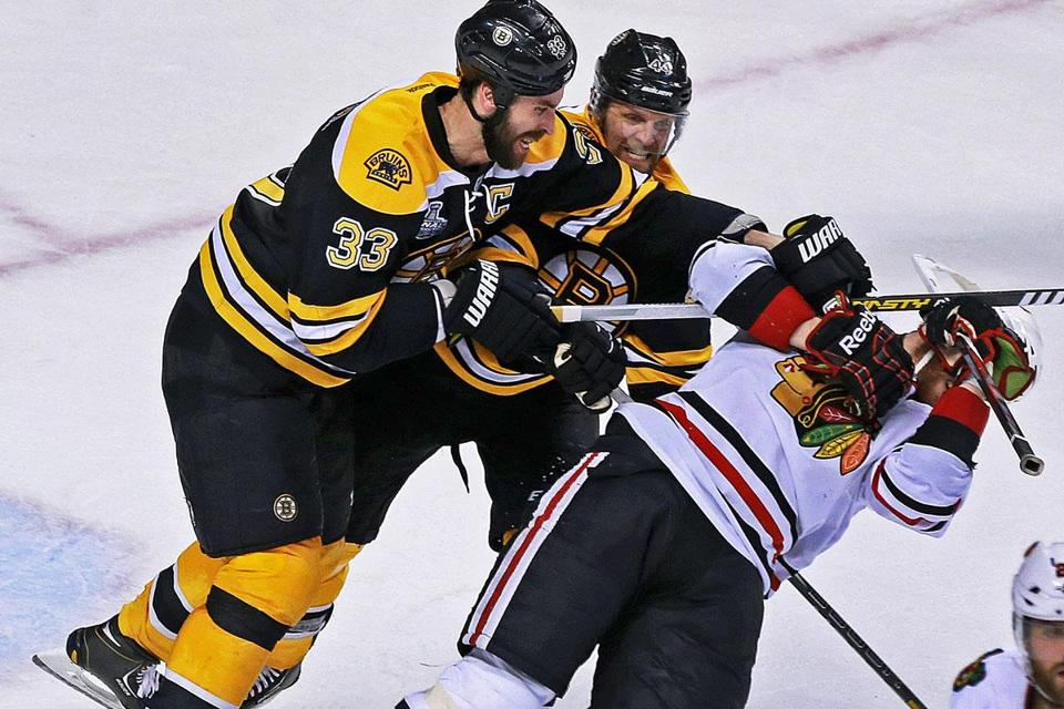 The Bruins delivered a physical message late in the game when Zdeno Chara (33) and Dennis Seidenberg roughed up Bryan Bickell.