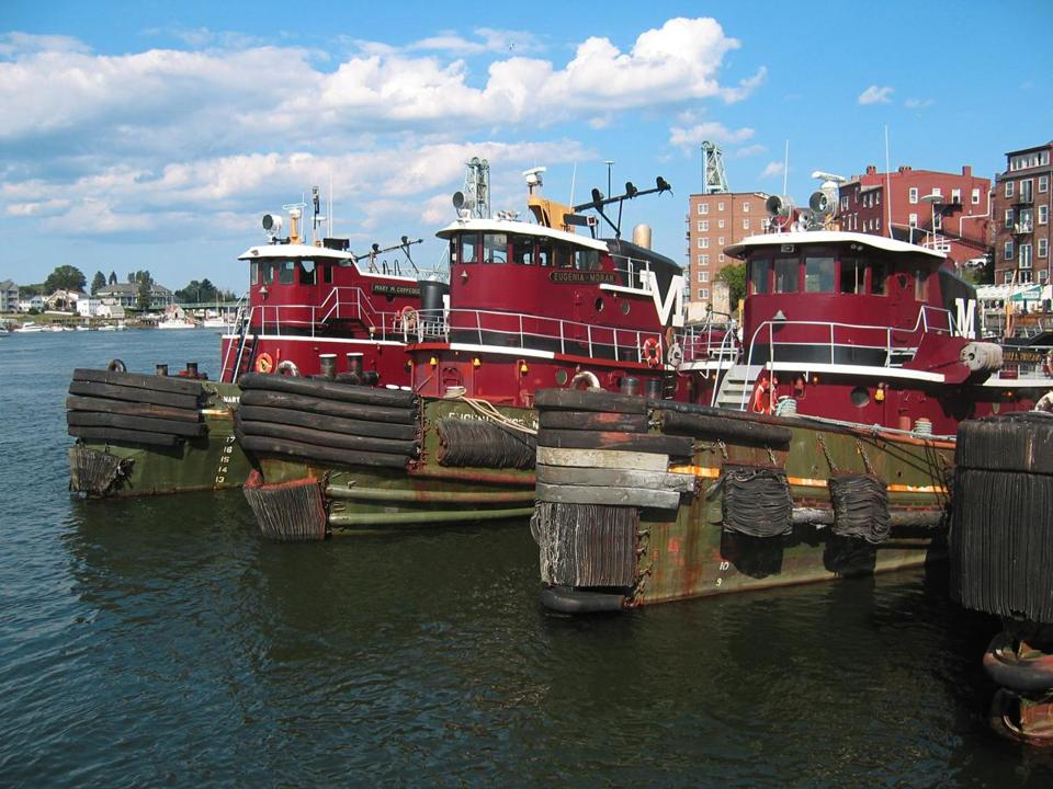Downtown Portsmouth's iconic red tugboats guide ships on the Piscataqua River.