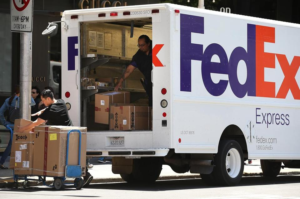FedEx shares are off 7 percent since March. Earnings fell from $550 million to $303 million.