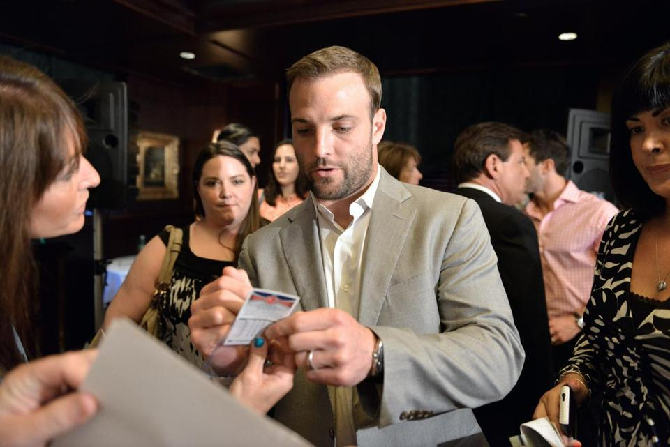 Wes Welker signs autographs at the Capital Grille in Chestnut Hill.
