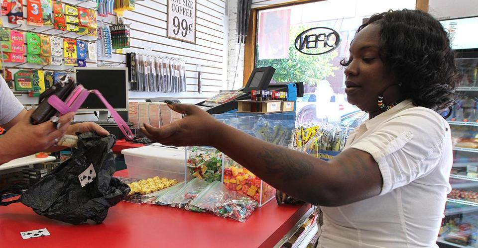 Iysis Greene paid $2 to store two cellphones at a store across from Dorchester District Court, where they are banned.