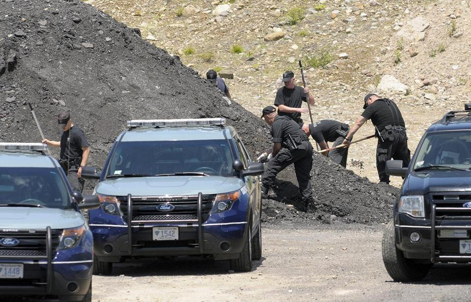 State Police dug for evidence Thursday in an industrial park in North Attleborough.