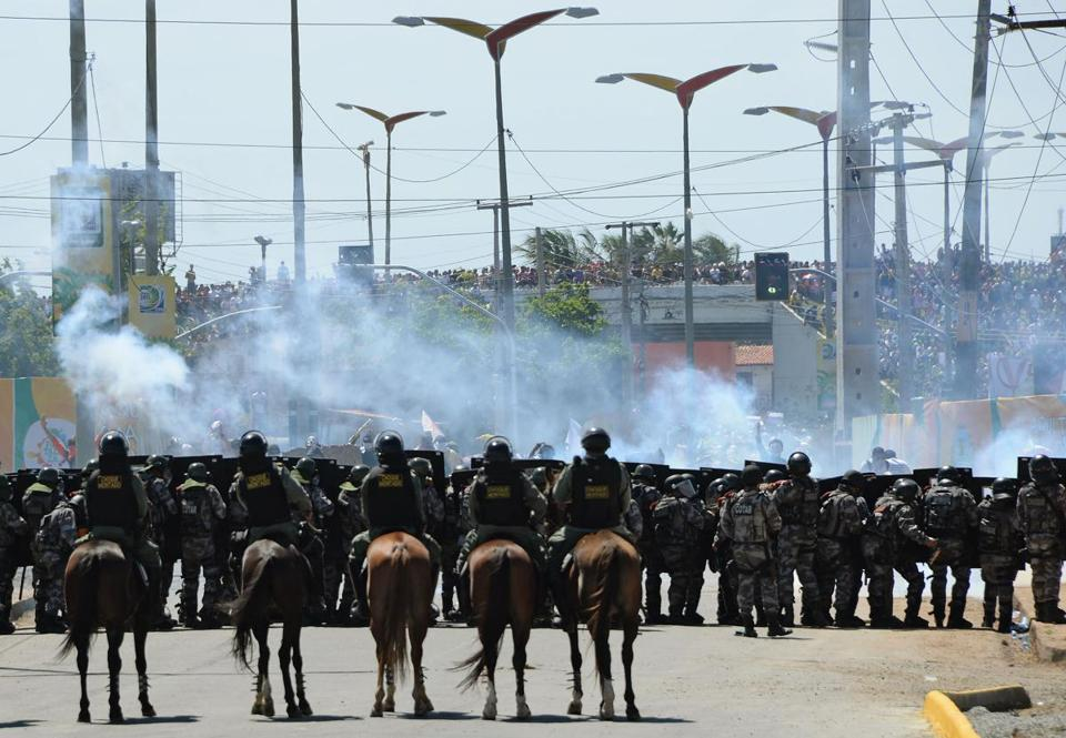 Riot police  clashed with protesters who blocked access to the Castelao Stadium in Fortaleza on Wednesday.